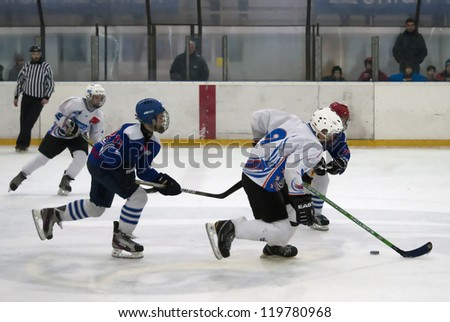 "BELGRADE,SERBIA-NOVEMBER 24:Unidentified ice hockey players in action with puck at "" Belgrade trophy  ice hockey tournament "". November 24,2012 in Belgrade,Serbia - stock photo"