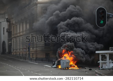 Belgrade, Serbia - October 10, 2010: a police car is on fire during the gay pride parade - stock photo