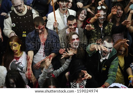Belgrade, Serbia - October 19, 2013: People dressed as a zombie parades on a street during a zombie walk in Belgrade, The zombie walk is part of the events of a upcoming Serbian SF movie festival.