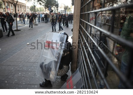Belgrade, Serbia - October 10, 2010: Riot police fight protesters in a street during the gay pride parade - stock photo