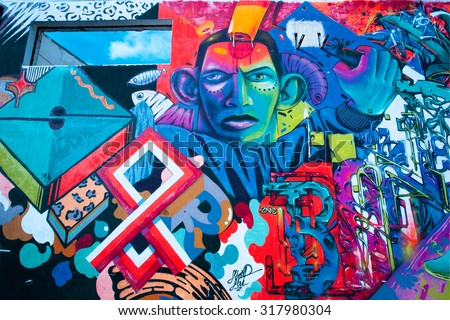 BELGRADE, SERBIA - SEP 15: Graffiti artwork with colorful patterns and african man face on the wall surface on September 15, 2015. Serbian capital - Beograd - has a population of 1.23 million people - stock photo