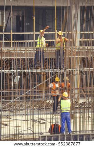 belgrade serbia september 09 2016 iron workers tying reinforcing rebar using pliers rebar worker