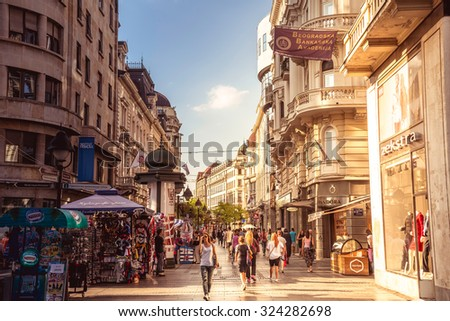 BELGRADE, SERBIA - SEPTEMBER 23: Knez Mihailova Street on September 23, 2015 in Belgrade, Serbia. Street is the main shopping mile of Belgrade. Filtered photo with warm summer lighting.