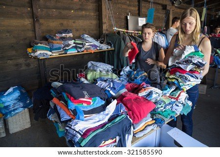 BELGRADE, SERBIA: SEPTEMBER 13, 2015: Volunteers bringing clothes for the immigrants and refugees from Middle East and North Africa heading to European countries. - stock photo