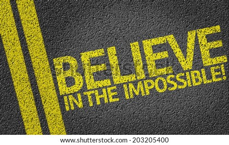 Believe in the Impossible written on the road - stock photo