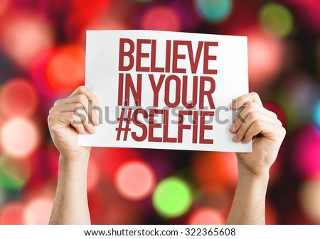 Believe In Your #Selfie placard with bokeh background - stock photo