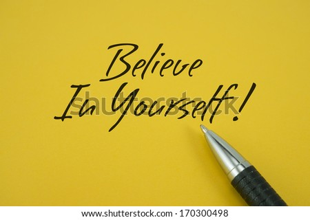 Believe In Yourself note with pen on yellow background