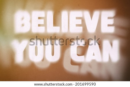 Believe you can word on vintage blurred background, concept sign - stock photo