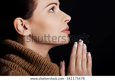 Believing woman praying to God
