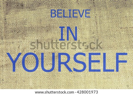 belive in yourself text on brown burlap. burlap, canvas texture retro background