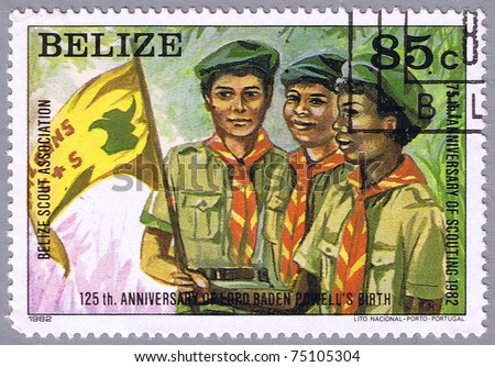 BELIZE - CIRCA 1982: A stamp printed Belize shows the scouts with a flag, series, circa 1982 - stock photo