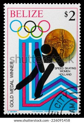 BELIZE - CIRCA 1980: a stamp printed in Belize shows the gold medal in speed skating women, Winter Olympics, Portugal, circa 1980 - stock photo