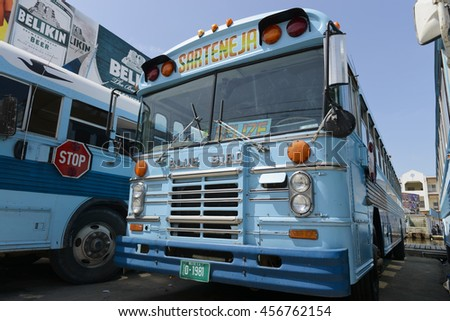 Belize City, Belize - July 14, 2016: Old Blue Bird buses still in service at a bus terminal in Belize City. - stock photo