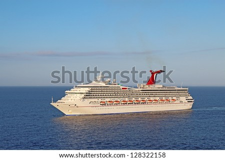 BELIZE CITY - DECEMBER 26: The cruise ship Carnival Triumph on December 26, 2011. An engine fire in February 2013 caused the ship to lose power and it was towed into port after being adrift for days. - stock photo