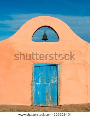 Bell over blue door in Santa Fe, New Mexico - stock photo