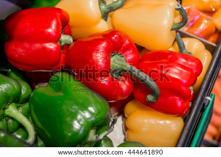 Bell Pepper close up for background Colorful sweet bell peppers, natural background. fresh bell peppers colorful mix of the hottest chili peppers.  variety colorful chili display in market store. - stock photo