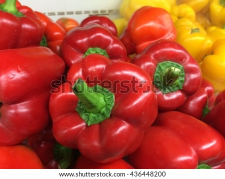 Bell peppers of different colors at a farmer's market  - stock photo