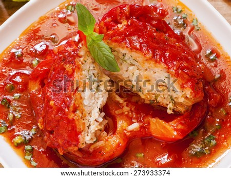 Bell peppers stuffed with meat, rice  and sauce on plate, selective focus - stock photo