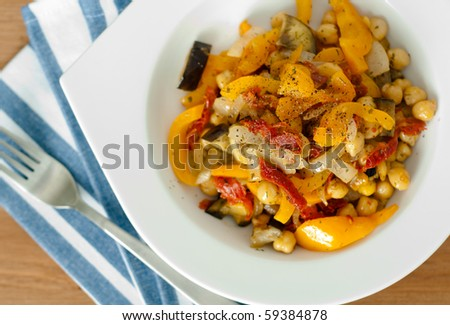 Bell Peppers, Sun-Dried Tomatoes, Cheak Peas prepared in Oil and Served