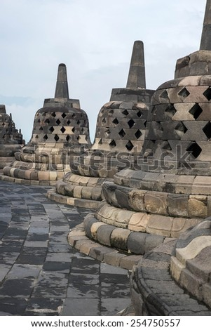 Bell shaped stone carvings at the top of Borobudur temple, Indonesia