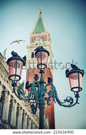 Bell tower and street lamp on St. Mark's Square, Venice - stock photo