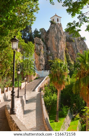 Bell tower, castle, Guadalest village, Alicante, Costa Blanca, Spain,  vertical - stock photo