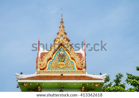 Bell tower in a Buddhism temple with blue sky. Wat Boon Na Rob in Nakhon si Thammarat, Thailand.