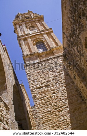 Bell Tower in Monastery of the Holy Cross -Orthodox monastery in Jerusalem and located in the Valley of the Cross.Now it is occupied by monks of the Jerusalem Patriarchate. - stock photo
