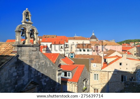 Bell tower of a church and distant buildings of the old town of Dubrovnik, Croatia - stock photo