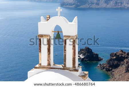 Bell tower of a Greek church in front of the sea in Santorini, Greece