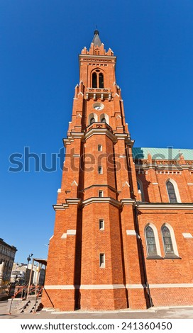Bell tower of catholic Basilica of the Dormition of Blessed Virgin Mary (circa 1897) in Lodz, Poland. Architect Konstanty Wojciechowski - stock photo