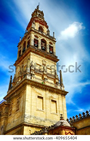 Bell tower of Cordoba Cathedral a clear blue sky in Andalusia, Spain.