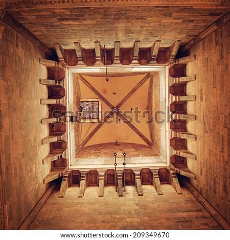 Bell Tower of the Basilica di Santa Maria del Fiore - instagram effect. Inside of Giotto's Campanile - retro photo filter. Belfry of Santa Maria del Fiore - vintage colors. Florence, Tuscany, Italy. - stock photo