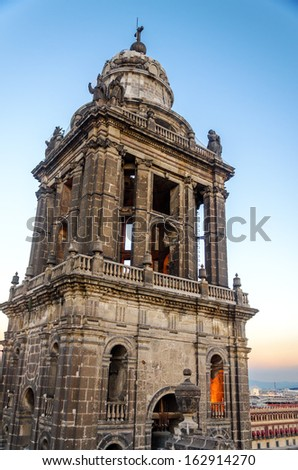 Bell tower of the cathedral in Mexico City taken in the evening - stock photo