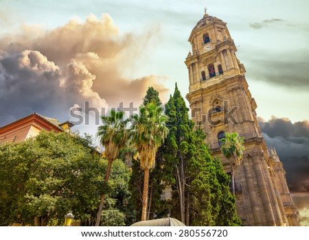 Bell tower of the Cathedral of the Incarnation in Malaga, Spain - stock photo