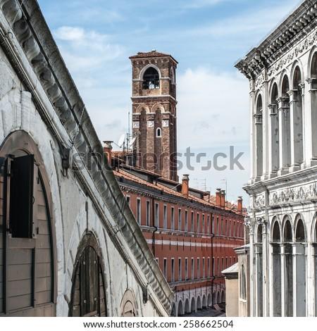 Bell tower of the roman catholic church of San Giovanni Elemosinario. Build in renaissance architectural style. View from Bridge Rialto. Venice, Veneto, Italy - stock photo