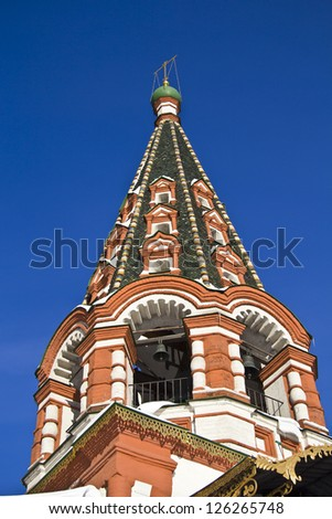 Bell tower of the Saint Basil cathedral on the Red Square in Moscow - stock photo