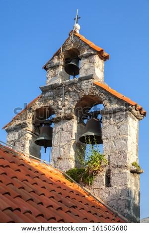 Bell tower of the Serbian Orthodox Church. The monastery Gradiste, Montenegro - stock photo