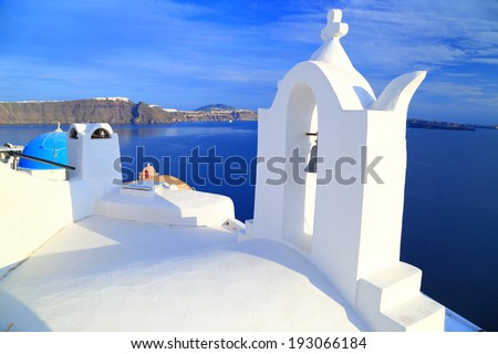 Bell tower of white church on the island of Santorini, Greece