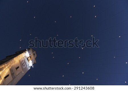 Bell Tower with Christmas lights and blue sky background, Leggiuno - Varese, Italy