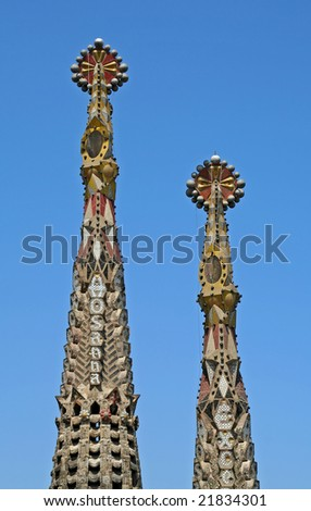 Bell towers of Sagrada Familia Church topped by venetian mosaics, Barcelona, Spain. - stock photo