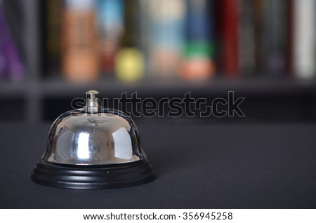 Bell with blur bookshelf background - stock photo
