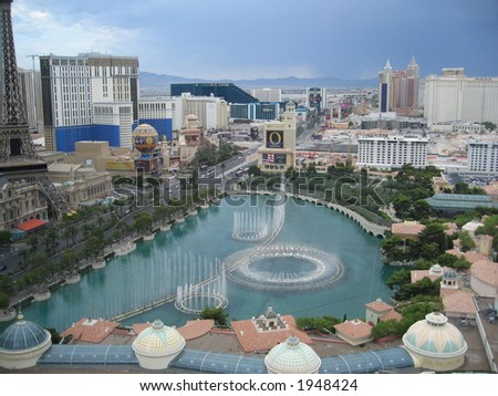 Bellagio fountains in Las Vegas across from the Eiffel tower - stock photo