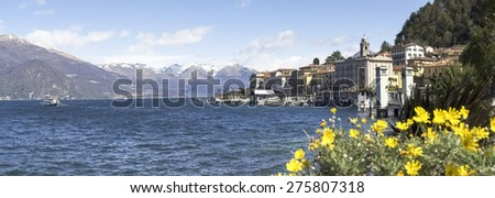 Bellagio lake of Como, Italy - April 1, 2015: Dock of Bellagio with nineteenth-century historic homes. The beautiful day is due to the wind from the north. - stock photo