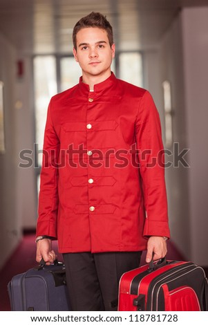 Bellboy with Luggages in the Hallway - stock photo