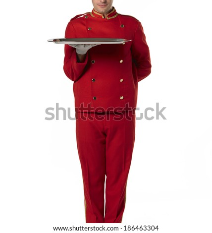 Bellboy with tray and red suit isolated on white. - stock photo