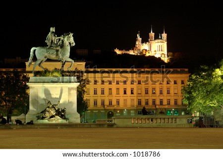 Bellecour square and the Fourviere hill (Lyon) with its equestrian statue of Louis XIV by the Lyons sculptor F. Lemot. Fourviere is a basilica - stock photo