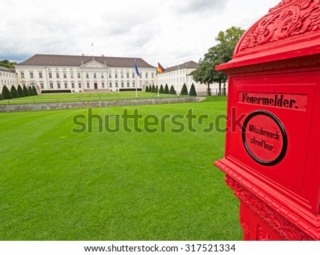 Bellevue Castle in Berlin with red fire alarm box - stock photo