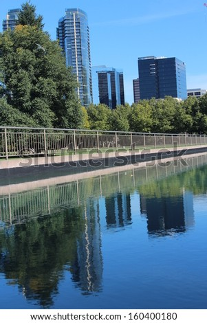 Bellevue Washington Downtown Skyscrapers Reflected in Park Pond - stock photo
