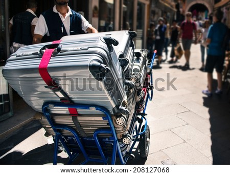 Bellhop hotel service at Venice street, Italy. - stock photo
